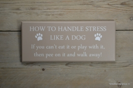 Tekstbord How to handle stress like a dog..