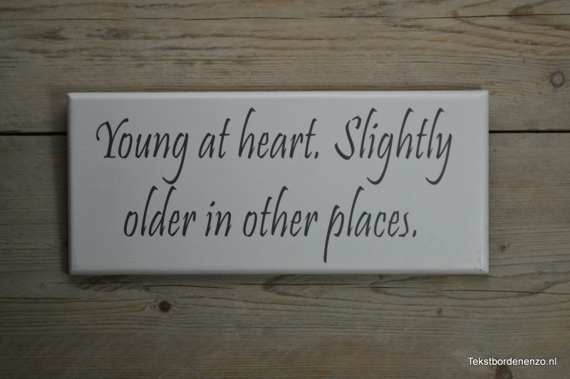 Tekstbord Young at heart, slightly older in other places