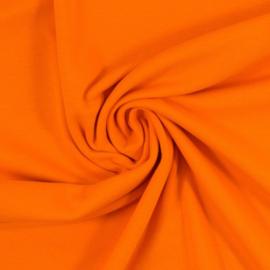 Boordstof: oranje. Rondgebreid 48 cm. Per 25 cm