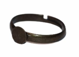 Verstelbare (kinder) ring ca 16 mm bronskleur met plakvlak 5 mm