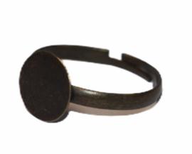 Verstelbare (kinder) ring ca 17 mm bronskleur met plakvlak 9 mm