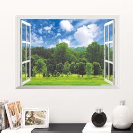Muursticker raamview bos met wolken