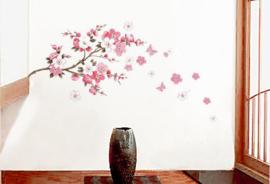 Muursticker tak met roze bloemetjes