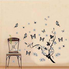 Muursticker tak met vlinders en bloemetjes