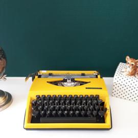 Typemachine Triumph Tippa okergeel