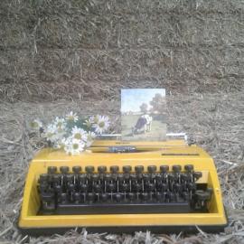 Typemachine Triumph Tippa geel