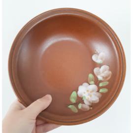Bruine aardewerk borden