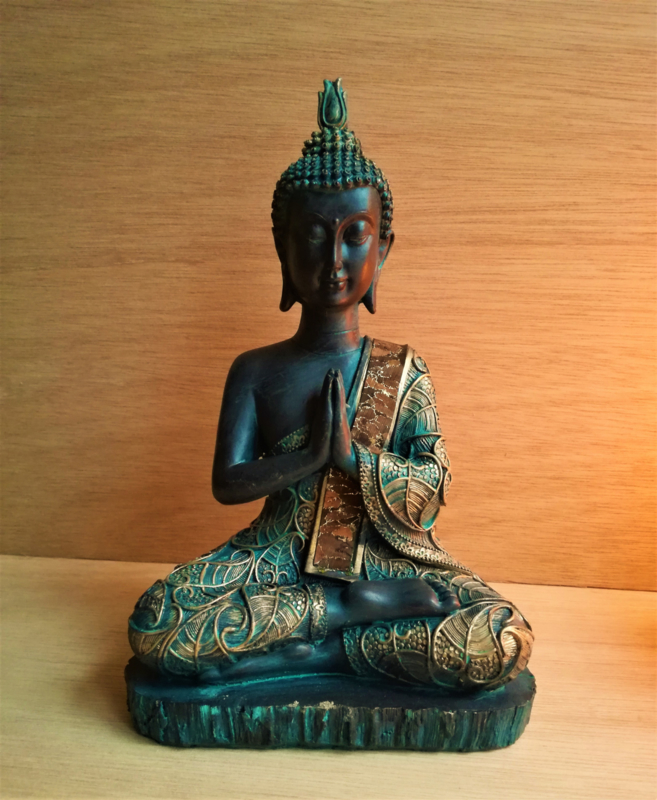 Boeddha in gebed