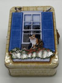 Blikje | Lapjeskat voor het raam