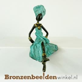 Zittende Afrikaanse vrouwenbeelden