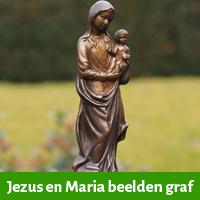 Jezus en Maria beeelden voor op het graf
