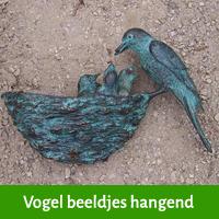 vogel beeldje schutting
