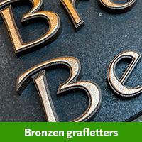 Bronzen grafletters