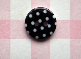 Knoop rond witte stip zwart