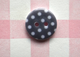 Knoop rond witte stip grijs