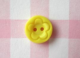 Knoop rond met bloem geel