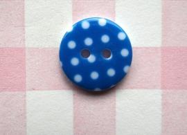 Knoop rond witte stip blauw