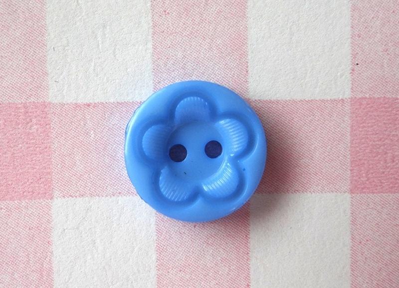 Knoop rond met bloem blauw