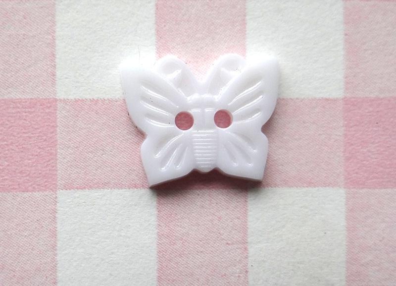 Knoop vlinder wit