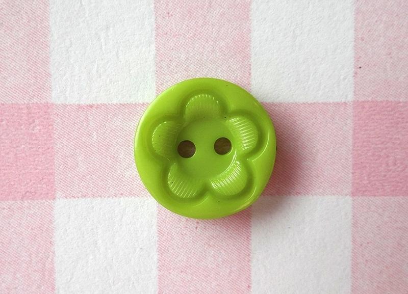 Knoop rond met bloem groen