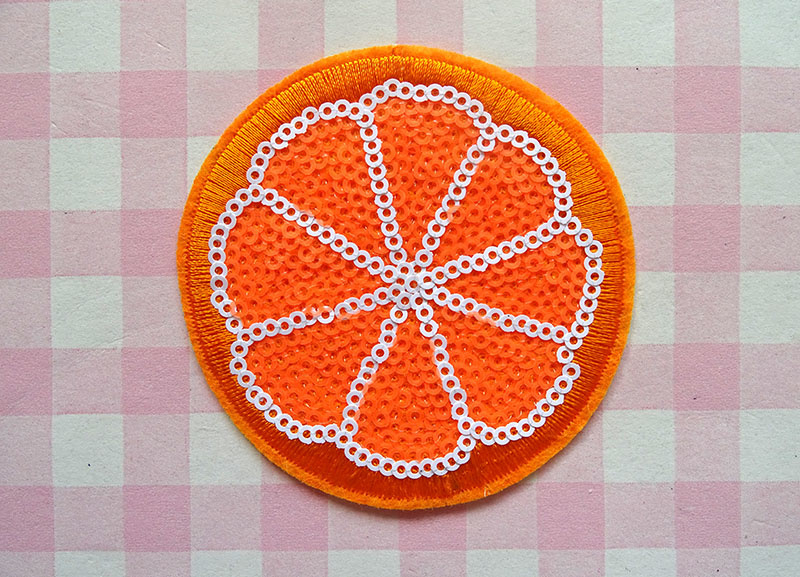 Strijkapplicatie sinaasappel pailletten
