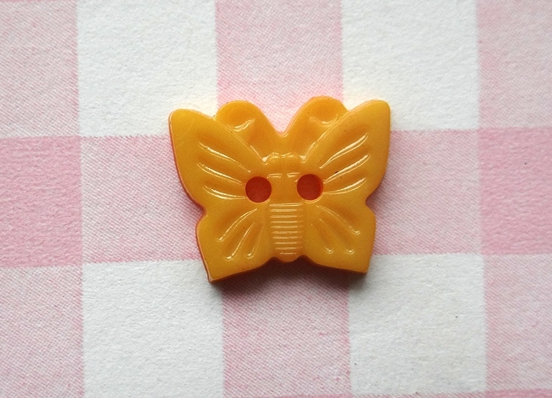Knoop vlinder licht oranje
