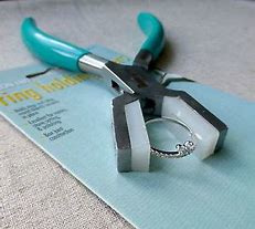 ring holding pliers