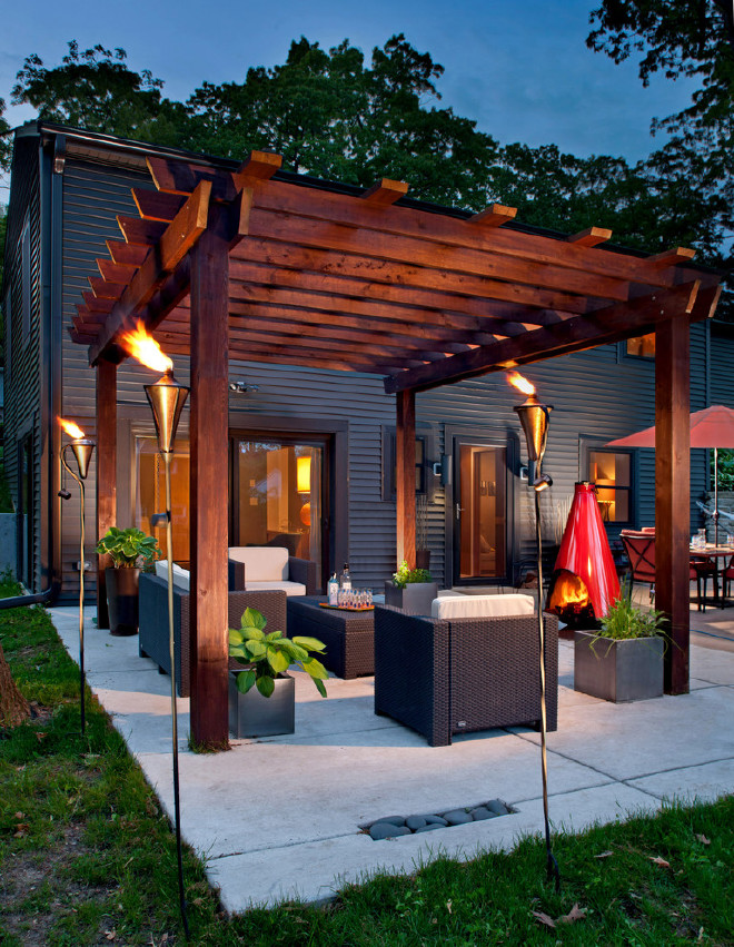 oil-torches-outdoor-contemporary-patio-with-concrete-patio.jpg