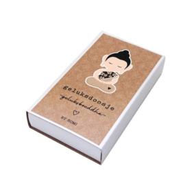 Geluksboeddha in een doosje
