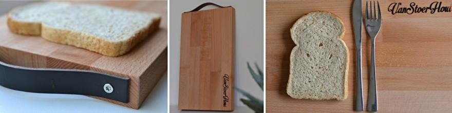 houten broodplank met leren handgreep voor actie brood op de plank