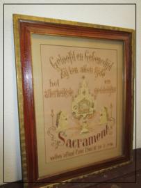 Antiek ingelijst geborduurd tafereel heilig sacrament in was