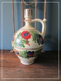 Oude hand beschilderde kruik keramiek
