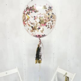 Helium filled bubble balloon with confetti