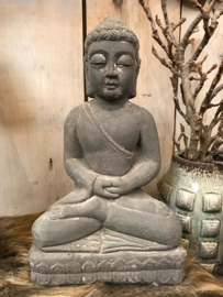 Cement statue sitting buddha