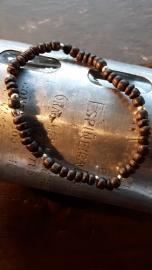 Houten kralen armband met metalen kralen