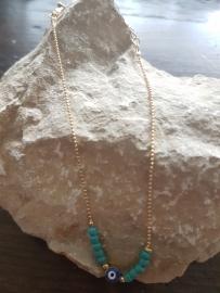 Verstelbare enkelbandje turquoise/goud met mooie oog kraal