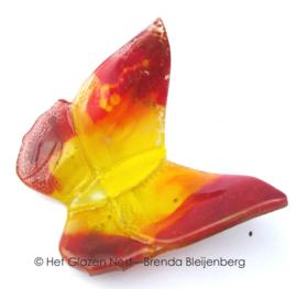 vlinder in rood en geel