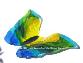 Grote vlinder in geel en aqua