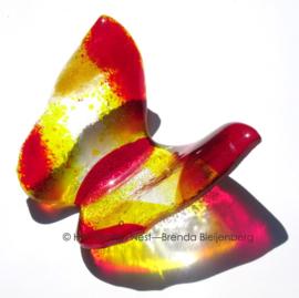 Vlinder in rood en gele glaskunst