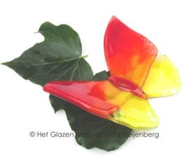 Vliegende vlinder in geel en rood