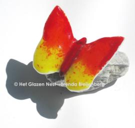 Glazen vlinder in oranje en geel