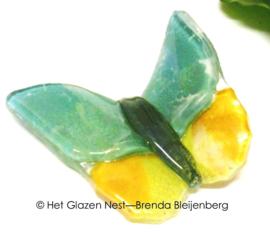 Klein groen en geel vlindertje