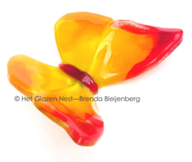 Oranje en gele vlinder van glas