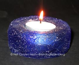 Waxinelichtje in blauw glas casting