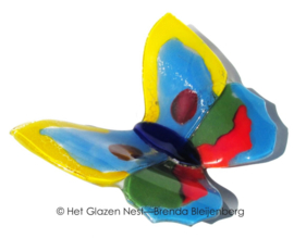 vlinder in fel gekleurd glas