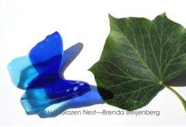 kleine vlinder in kobalt en aqua blauw