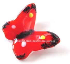 kleine rode vlinder met kleurige accenten