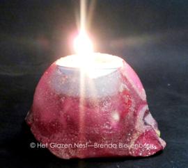 Waxinelichtje in roze kleuren