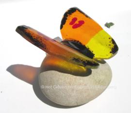 Vlinder in oranje en geel