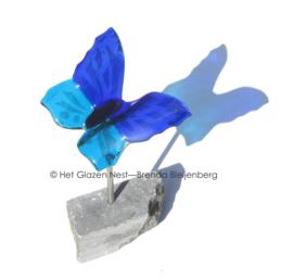Vliegende blauwe vlinder
